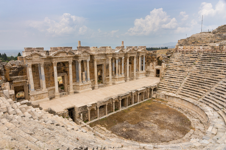 The colonnade of the Theatre and amphitheatre at Hierapolis near Pamukkale in Turkey now a UNESCO World Heritage Site originally part of an ancient resort around the hot springs 스톡 콘텐츠