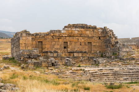 Ancient stone ruins in the Greek spa of Hierapolis in Anatolia, Turkey near the travertine hot springs at Pamukkale