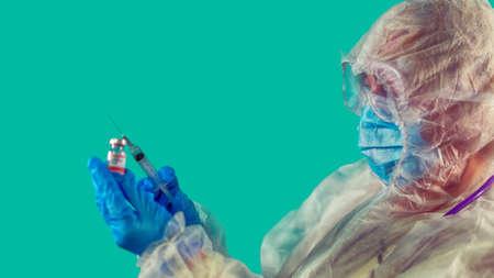 vaccine in researcher's hands