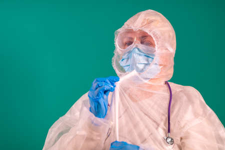 A doctor puts on a PPE suit uniform with a stethoscope on the shoulder, wearing a medical protective Mask and glasses on the face