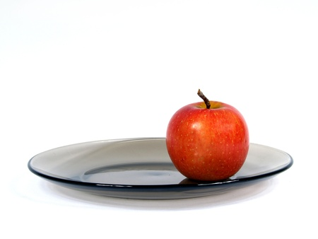 apple resting upon plate