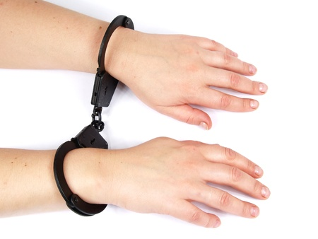 feminine hands shackled in manacles         Stock Photo - 8946903