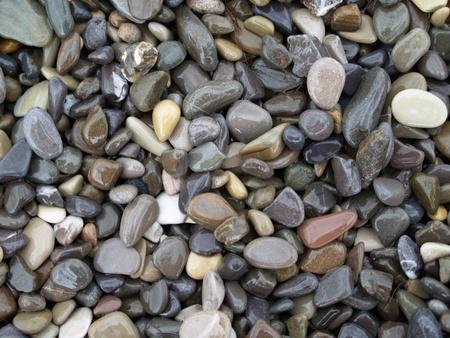 wet sea pebble forming gray background, invoice Stock Photo - 8946930