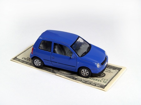 car on money bill Stock Photo