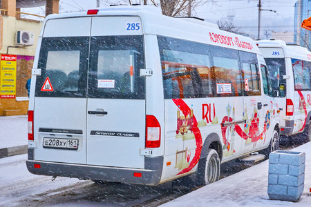 Rostov-on-Don / Russia - January 2018: Shuttle bus mercedes-benz sprinter on route number 285 to the new airport Platov moves along the route through the streets of the city