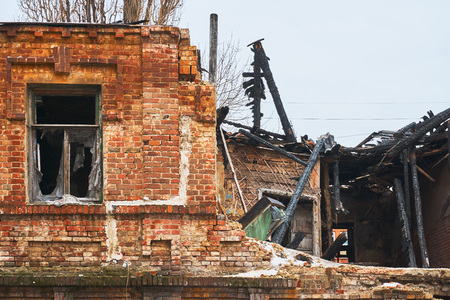 Ruined old house after a fire in the center of a big city