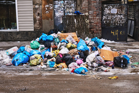 Rostov-on-Don / Russia - February 2018: Garbage dump on the street in the center of a big city from waste packages
