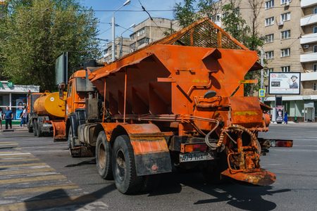 Rostov-on-Don  Russia - May 2018: Large and heavy trucks cleaners of the road service in orange block the road when holding a city holiday for safety Editorial