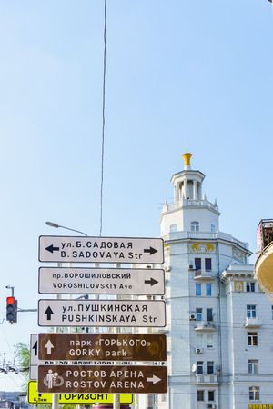 Rostov-on-Don  Russia - May 2018: Signposts on high poles show the direction to the new Rostov Arena stadium in two languages for foreign tourists and football fans