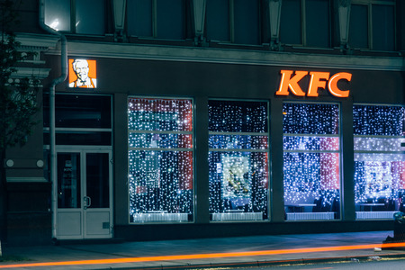 Rostov-on-Don  Russia - May 2018:  The KFC restaurant lights at night on the central street of the city and prepares for the opening and the first hungry visitors