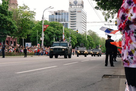 Rostov-on-Don  Russia - 9 May 2018: The military armored car drove through the streets of the city in honor of the Victory Day Victory Day on May 9, 1945, this is observed by a lot of people