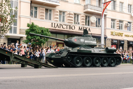 Rostov-on-Don  Russia - 9 May 2018: Military equipment The T-34 tank passed through the streets of the city in honor of the Victory Day Victory Day on May 9, 1945, this is observed by a lot of people