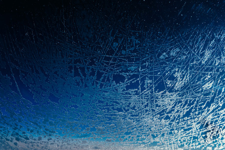 the porthole of a large passenger plane froze and was covered with a layer of ice with beautiful patterns during a flight at high altitude on a frosty winter day Stock Photo