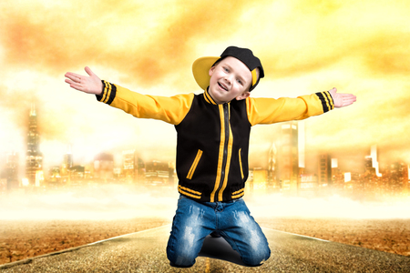 The little boy in the style of Hip-Hop. Childrens fashion.Cap and jacket. The Young Rapper.Cool rap dj.