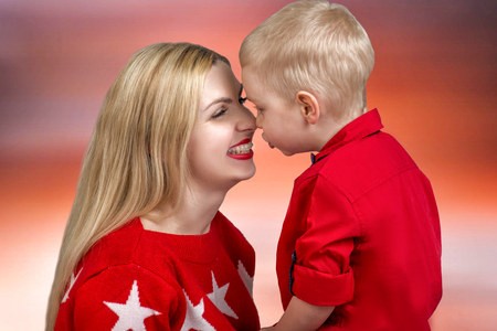 A mother kisses her child. Little boy a tender embrace.
