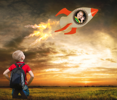 man flying: Two brotherss play in Astronauts. The boy looks at the launch, which flies brother. Children dream to go to space to conquer the stars. First flight.