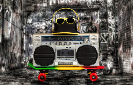 grabadora: The concept of the music Hip hop style.Vintage audio player with headphones.Skateboard deck, fashionable cap and sunglasses.isolated Foto de archivo