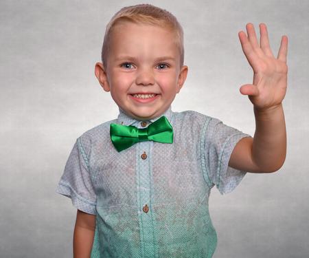 Pretty positive boy. Portrait of a happy, stylish baby. 版權商用圖片