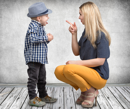 A young mother scolds her naughty little son.