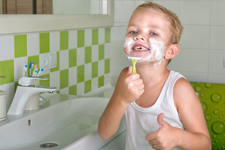 toilet: Little boy learning to shave. Wants to be like dad.