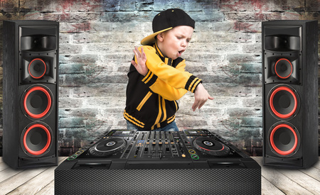 The little boy in the style of Hip-Hop. Cool rap dj. Children's fashion.Cap and jacket. The Young Rapper.