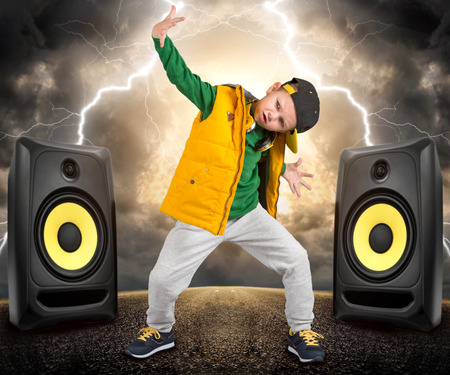 The little boy in the style of Hip-Hop. Children's fashion.Cap and jacket. The Young Rapper.Cool Dancer. Banco de Imagens