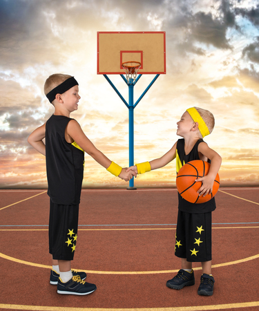Two brothers in the form of a basketball play in street basketball.