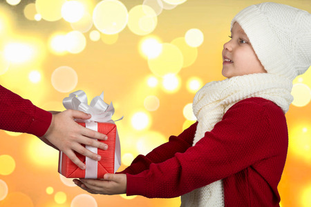 The brothers exchange Christmas gifts.The hands of children with a gift.Merry Christmas and Happy Holidays!
