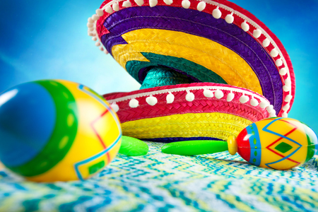Mexico. Sombrero and maracas on a colored background. Stock Photo