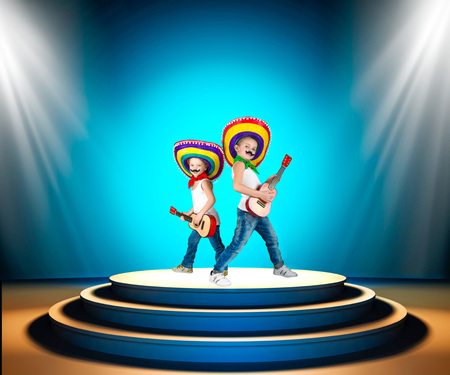 Mexican party.Two boys in sombrero with a guitar on stage.Mexican macho.