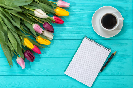 Spring background! A bouquet colorful tulips and an empty notebook for romantic entries Stock Photo