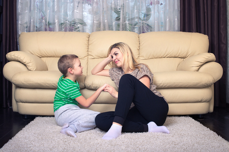 Mother and son sitting at home and talking, Family time. Stock Photo