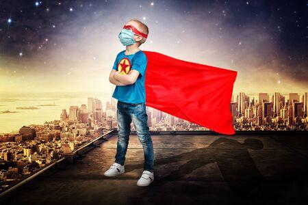 Boy superhero saves the world.Novel coronavirus - 2019-nCoV, Virtual reality, the fight against the virus.Coronavirus outbreak.COVID-2019.The concept of the virus