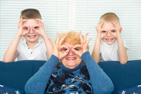 Grandmother and grandchildren play together. A happy, cheerful family.