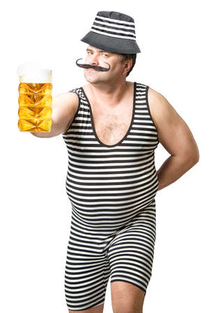 Cheerful man in a striped suit with a glass of cold foamy beer.