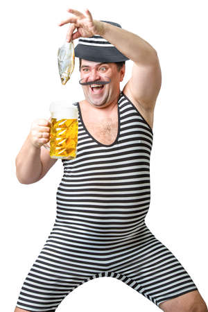 Cheerful man in a striped suit with a glass of cold foamy beer and dried fish. 版權商用圖片