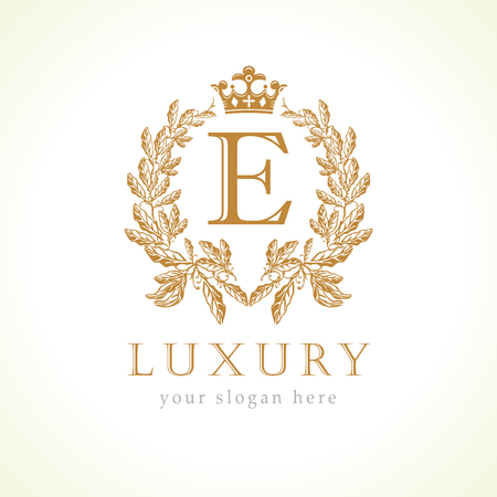 Luxury E letter and crown monogram logo. Laurel elegant beautiful round with crown and wreath.