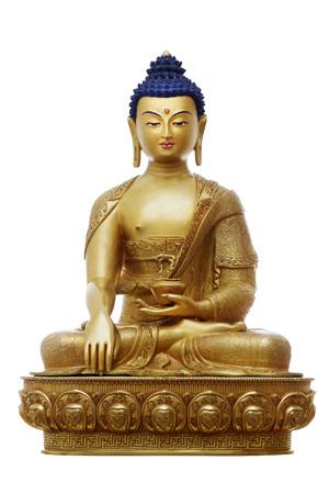 Beautiful shining classical Buddha Shakyamuni (Siddhartha Gautama) golden statue with open eyes isolated on the white background. The figurine made in traditional Tibetan style