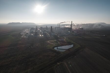 production of potash fertilizers, smoke from pipes creates pollution. shot by drone Stock Photo - 138461339