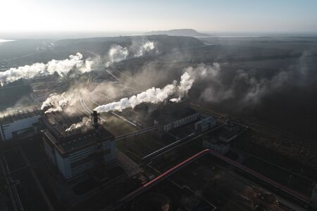 production of potash fertilizers, smoke from pipes creates pollution. shot by drone Stock Photo - 138461138