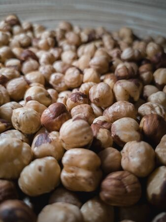 fried and poorly peeled hazelnuts, lies in a large bowl