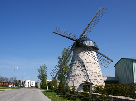 Ancient windmill on a background of the blue sky