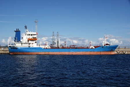 The tanker is moored in the port and loaded fuel Stock Photo