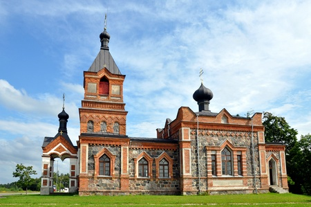 The church is constructed of a red brick and greater stones
