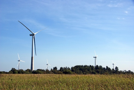 The wind generator on a background of the nature and the sky