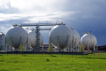 Gas tanks on a background of the dark sky Stock Photo