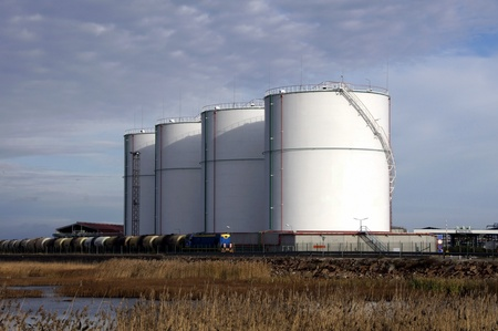 tanks: Large white tanks for petrol and oil