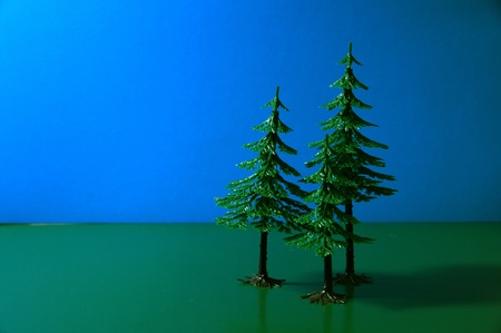 Trees on a dark blue and green background Stock Photo - 11588800