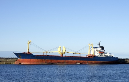 The cargo ship costs at a mooring Stock Photo