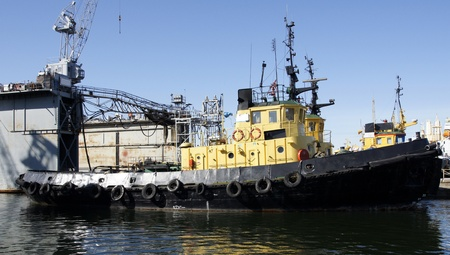 Tug boat costs in port at a mooring photo